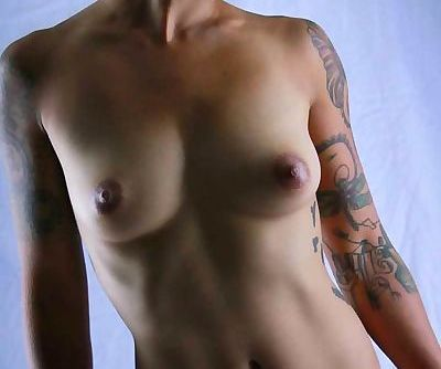 Shaved head- asian- tattoos-..