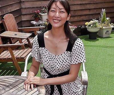Asian MILF Miki Sugimoto rubs her..