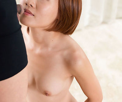 Nude Asian female sucks a cock on..
