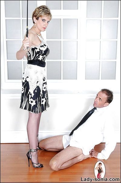 Fully clothed femdom on high heels torturing her submissive male pet