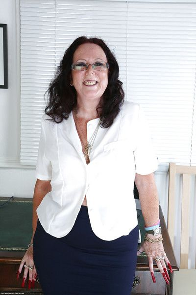 Mature secretary Zadi in sexy glasses and stockings becomes wild alone