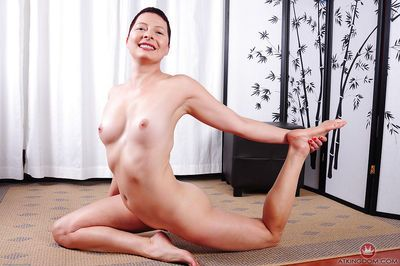 Short haired older dame Kali Karinena striking yoga pose in the buff - part 2