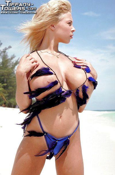 Masturbating aged blonde pornstar Tiffany Towers baring big tits on beach