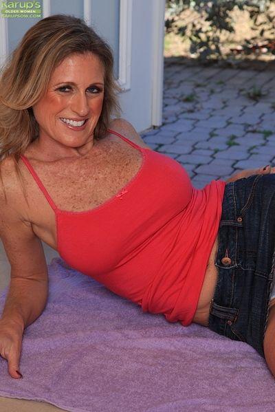 Mature dirty blonde Jade Jamison orgasming after toying shaved vagina