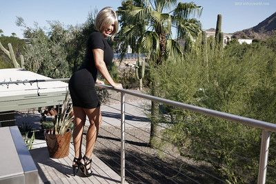 Buxom older housewife Sandra Otterson flashing thong covered ass outdoors