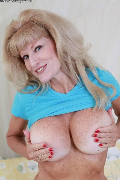 Older lady Cam Raye revealing huge mature juggs in retro hairstyle
