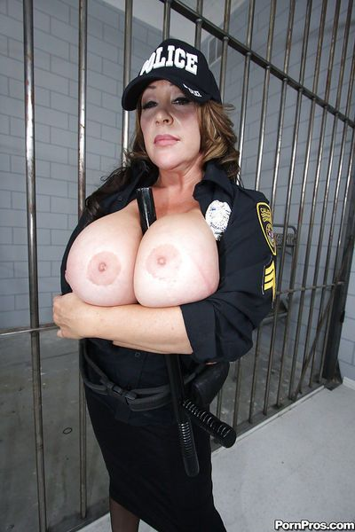 Busty mature babe Kandi Kox strips off uniform to tease her tits - part 2
