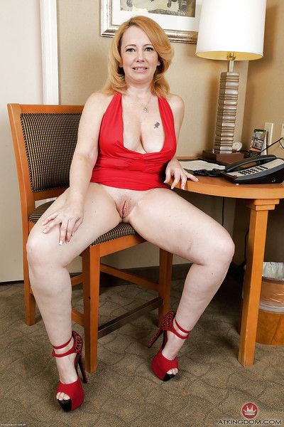 Chubby mature woman Brandie Sweet spreading shaved mature pussy