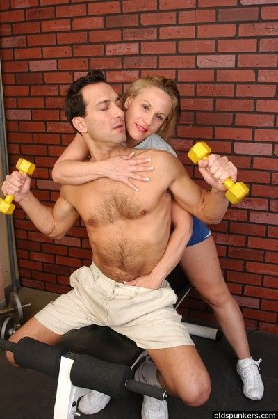 Mature woman Summer seducing younger man in weight room for sex