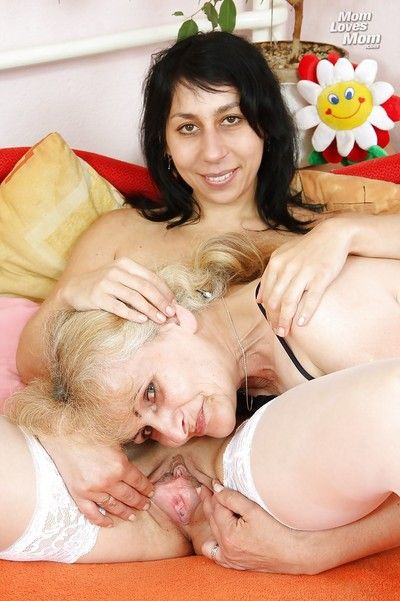 Slutty granny and her mature lesbian friend playing with their sex toys