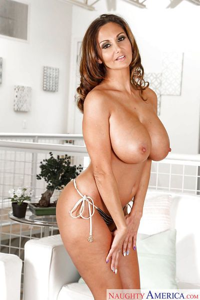 Curvy MILF Ava Addams posing solo in bikini top and thong underwear
