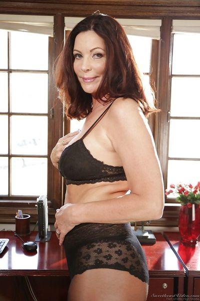 Older boss lady Magdalene St Michaels strips off skirt and hose for nudes
