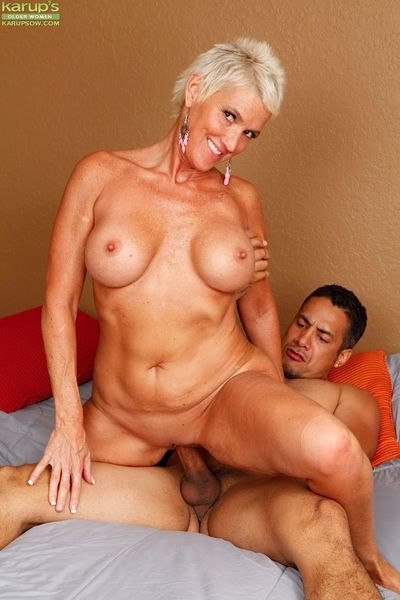 Mature mom Lexy Cougar taking cumshot on large tits after riding cock