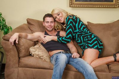 Blonde Sasha Sean suck this dudes hard cock on the cute couch