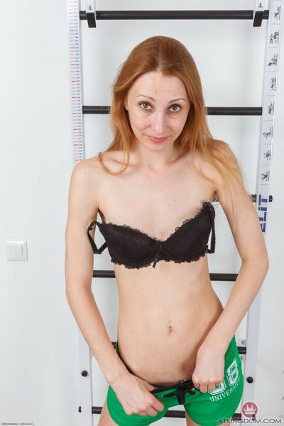 Skinny mature woman Kler does a slow striptease to expose her hairy pussy