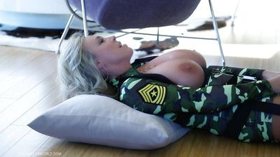Aged blonde housewife Sandra Otterson lets hooters free from military clothes