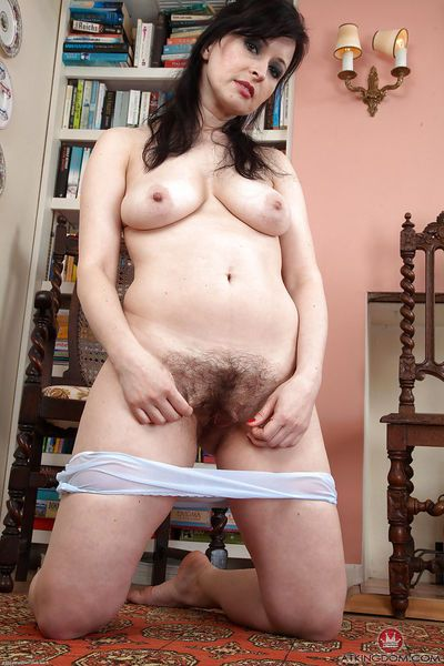 Mature dame Nikita releasing her hairy pussy from see through underwear