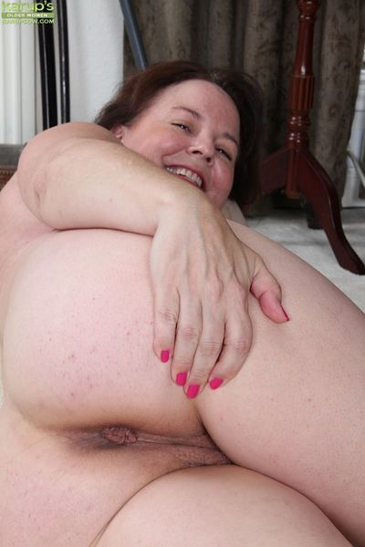 Older housewife Felicia McDonald flashes saggy mature tits and panties