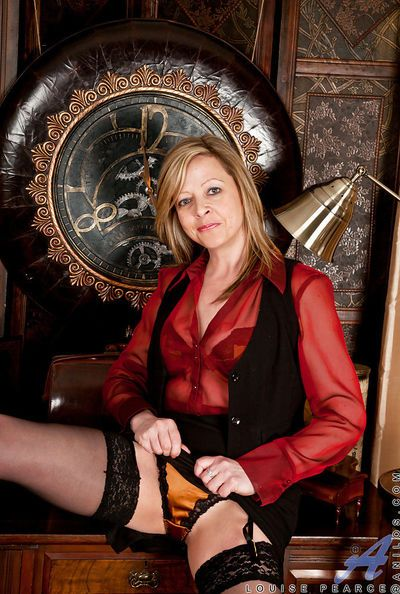 Lusty mature lady in stockings Louise Pearce slipping off her clothes