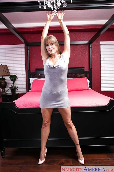 Experienced nude model Darla Crane shows off her great mature woman legs