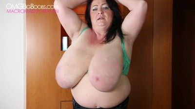 Chubby brunette milf proudly displays humongous melons