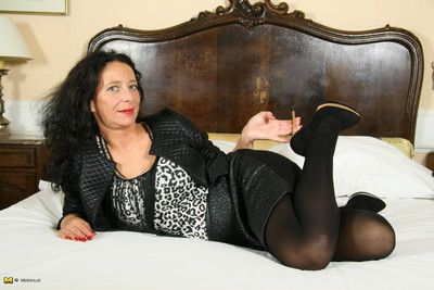 Naughty housewife playing on her bed