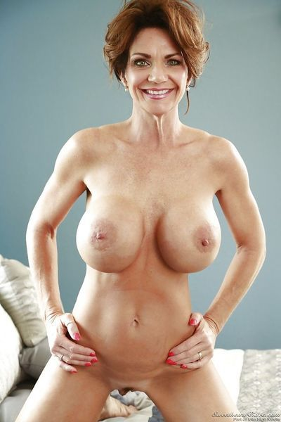 Mature bombshell with huge round jugs getting nude and spreading her legs - part 2