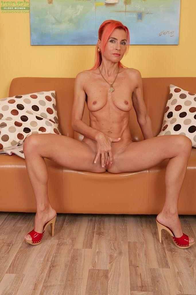 Mature redhead Klarisa Hot shows her fuckable booty on camera