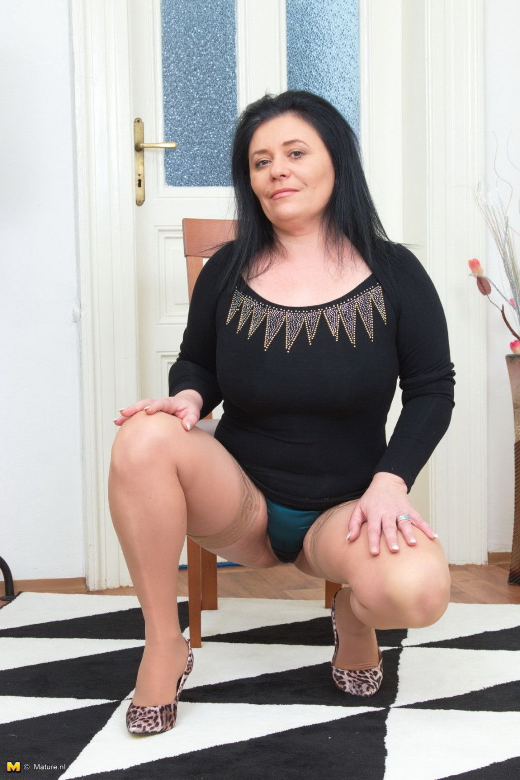 Chubby housewife stripping and teasing