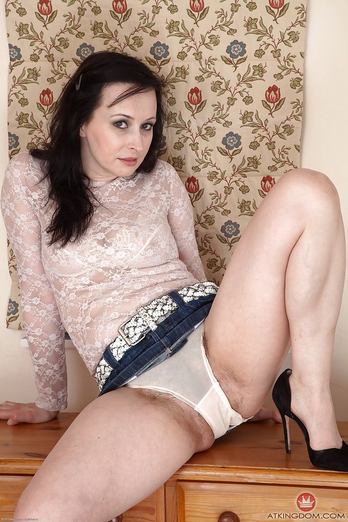 Mature woman flashes upskirt panties before exposing hairy cunt