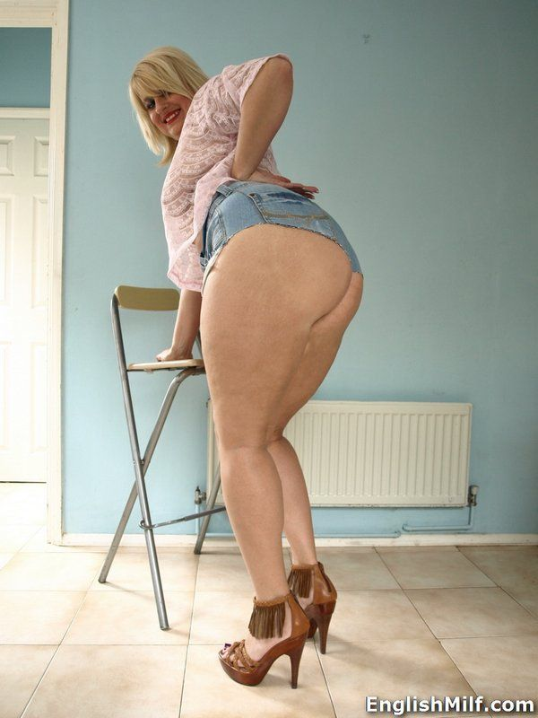 Thick older blonde Daniella English sliding cutoff shorts over big ass