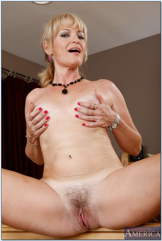 Blond mom Tina Tosh stripping and spreading her nice hairy pussy