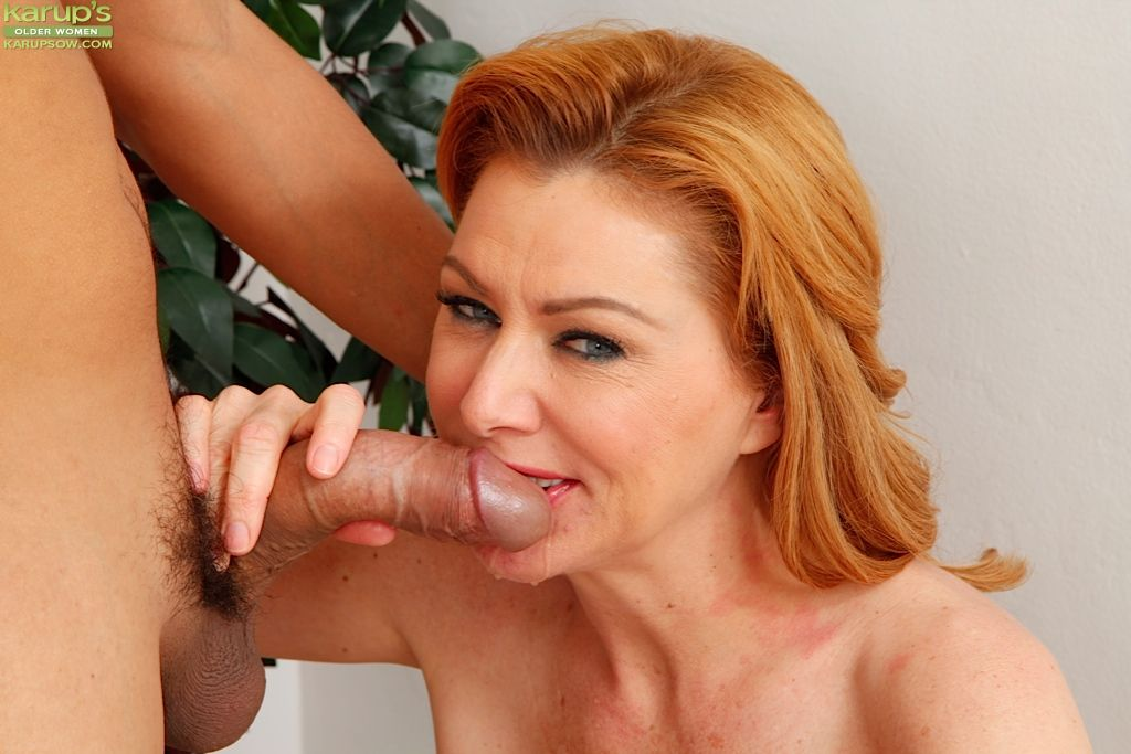 Older redhead Sasha Sean uses shaved pussy to ride husbands dick