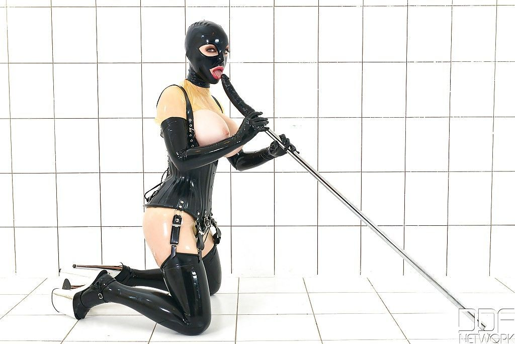 BDSM enthusiast Latex Lucy toying MILF pussy in fetish clothing and hood - part 2