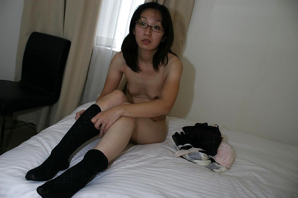 Skinny asian MILF in glasses undressing and exposing her twat in close up - part 2