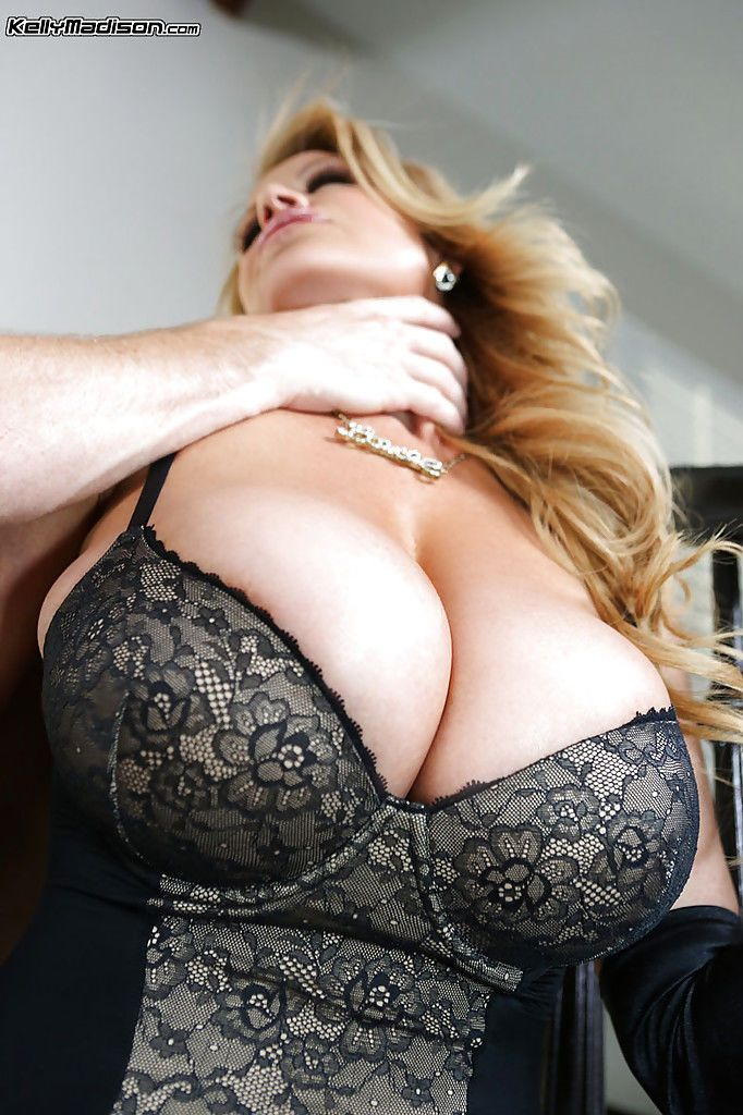 Kelly Madison has her big tits kissed and her shaved pussy fucked hard