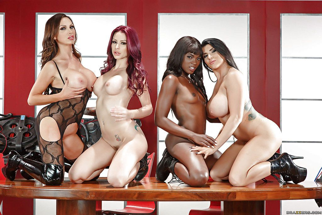 Black and white pornstars in boots model naked on desk in all girl orgy