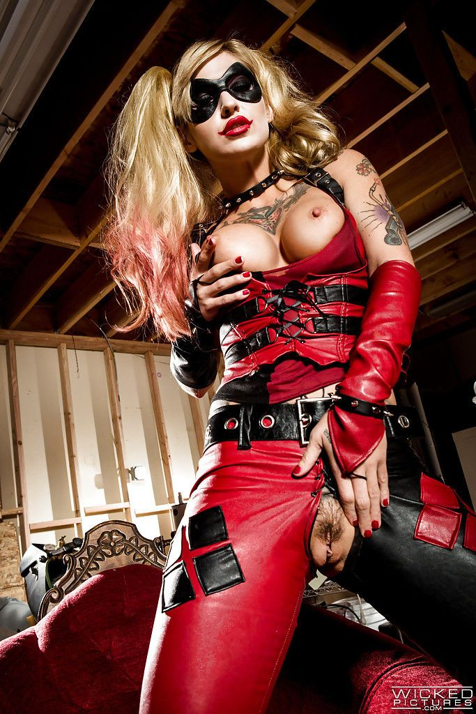 Blonde cosplay model Kleio Valentien modeling in crotchless leather pants