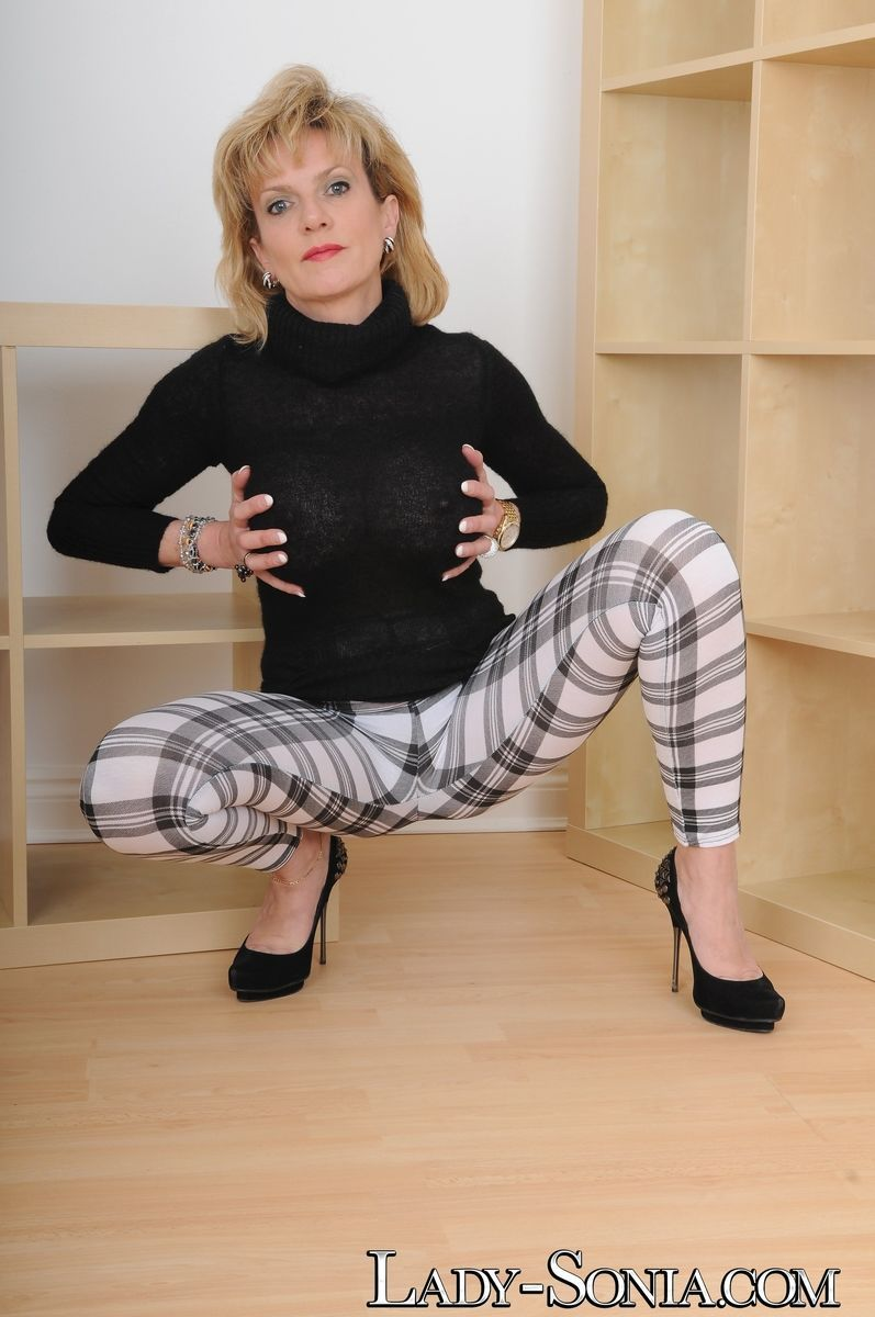 British MILF Lady Sonia teasingly shows off big tits and thong attired ass
