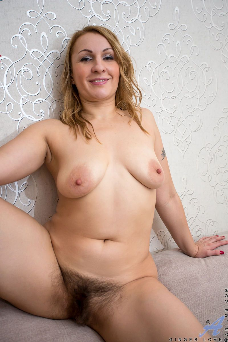 Mature woman in lace panties showing of very hairy pussy & saggy boobs