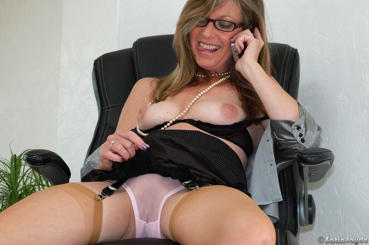Mature secretary Satin Jayde cant resist showing off her best assets at work