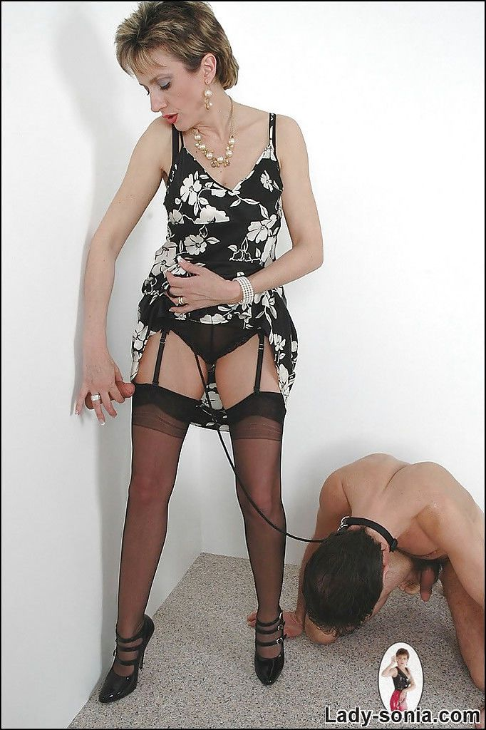 Hot femdom has some gloryhole fun while her male pet licking her high heels