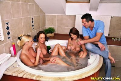 Three hot MILFs are into groupsex in the bath with their friend