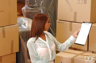 Redhead Latina Katia Due Lys discovers gloryhole among shipping boxes
