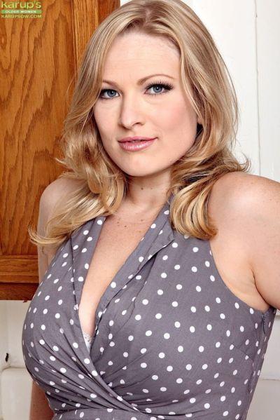 Blond plumper Vicky Vixen flashing white upskirt underwear in kitchen