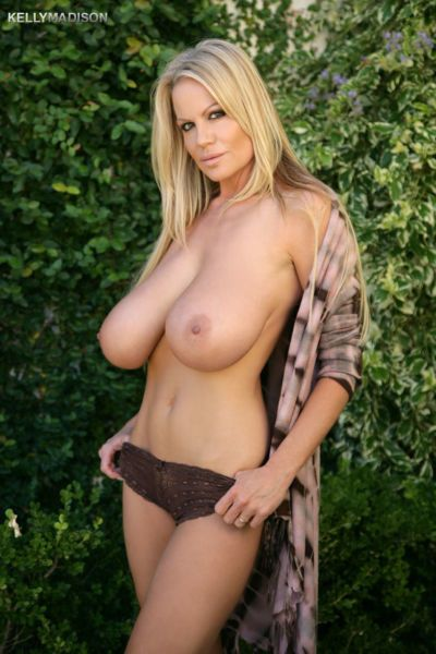 Blonde MILF Kelly Madison shows off her huge saggy tits in various locations