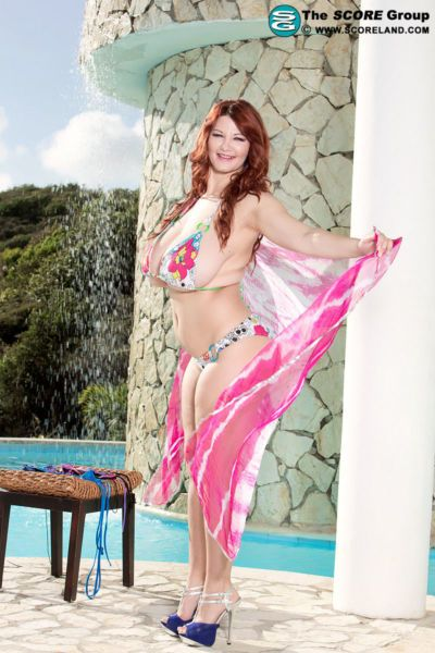 Chubby redhead model Vanessa Y releases her massive boobs from bikini top