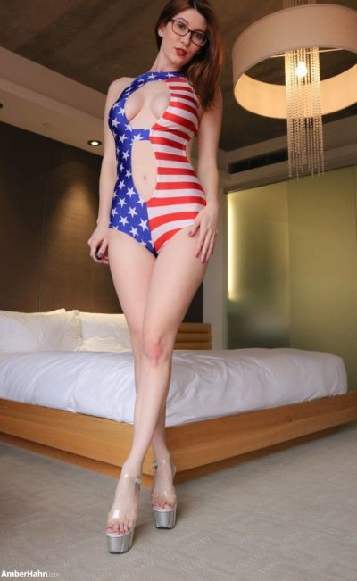 Nerdy babe Amber Hahn releases her perfect tits from USA themed swimsuit