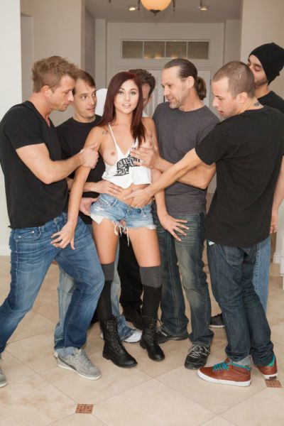 Redhead pornstar Ariana Marie sucks off numerous cocks at the same time