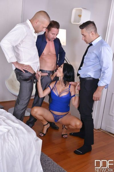 Brunette MILF Jasmine Jae throats cocks in sloppy modes while at the office